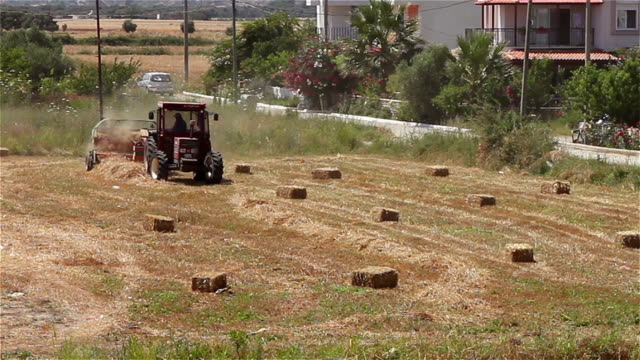 baler making straw bales - haystack stock videos & royalty-free footage