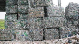 Bales of Compressed Recyclable Materials Stacked Outdoors