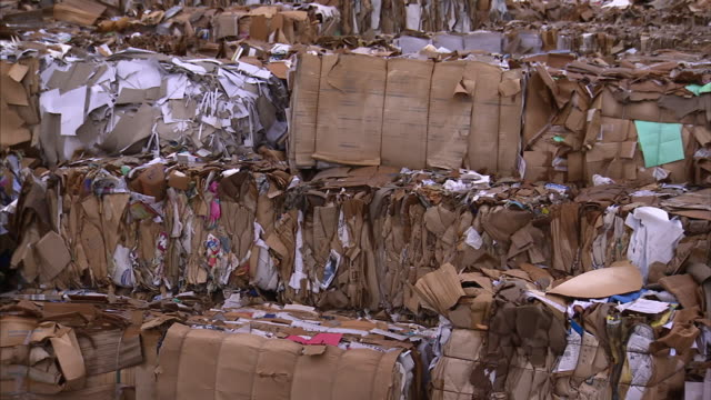 bales of paper wait for recycling at a paper drop off facility. - hay bail stock videos & royalty-free footage
