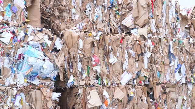 bales of recyclable paper at a sorting centre - paper mill stock videos & royalty-free footage