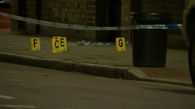 balham shooting leaves victim in hospital england london balham police at scene of shooting police tape and markers on road police cordons and... - itv london lunchtime news点の映像素材/bロール