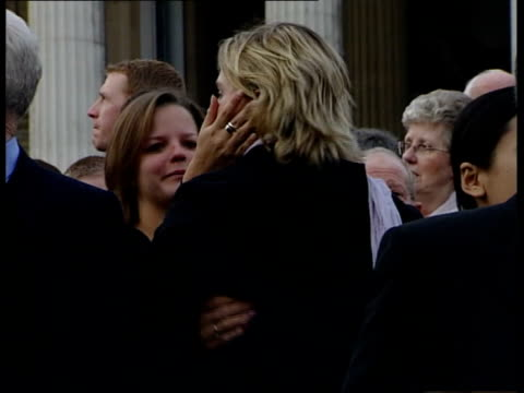 first anniversary itn england london trafalgar square photograph of victim of bali bombing held by relative at memorial service pull out to other... - side lit stock videos & royalty-free footage