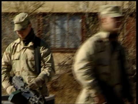 bali bombing islamic cleric abu bakar bashir arrested afghanistan bagram ext us soldier along on patrol - bagram stock videos & royalty-free footage
