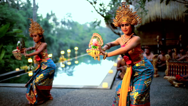 balinese females performing artistic dance in ceremonial costume - bali stock videos & royalty-free footage