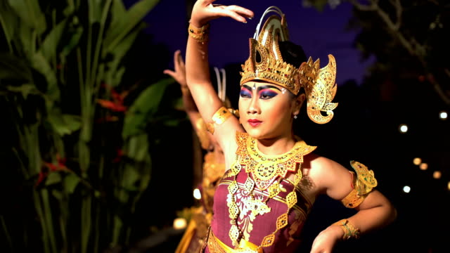 balinese females performing artistic dance in colorful costume - balinese culture stock videos & royalty-free footage