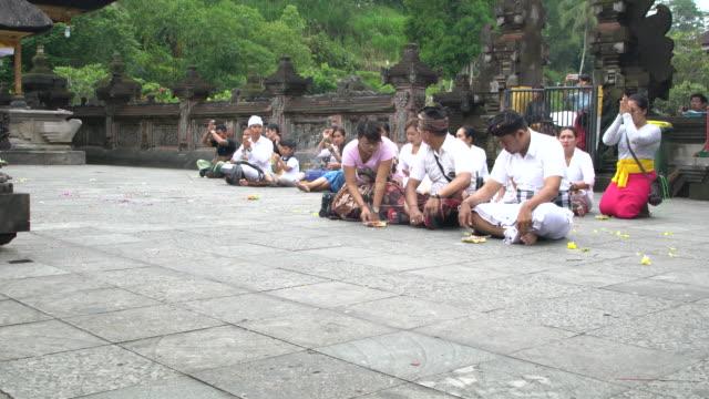 Balinese Hindus Praying At Pura Tirta Empul Temple, Bali