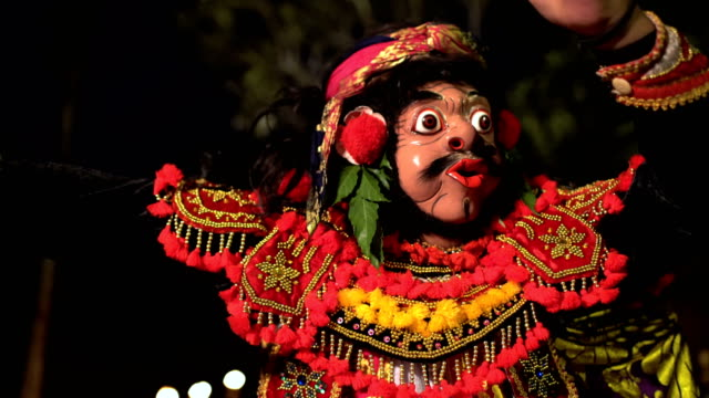 Balinese magical clown mask figure in ancient performance