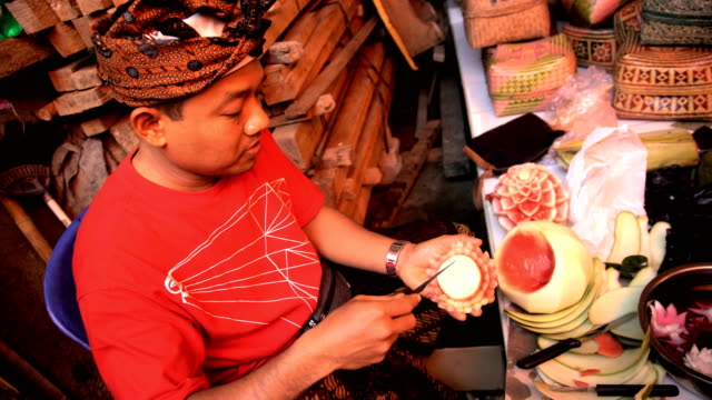 balinese mertarauh decorative fruit flower carving by knife - carving knife stock videos and b-roll footage