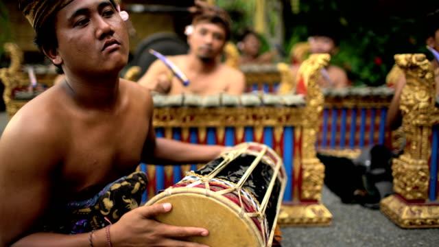 balinese musician gamelan group playing in traditional dress - bali stock videos & royalty-free footage