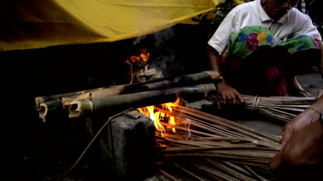 balinese outdoor male making open fire for cooking - indonesia street stock videos & royalty-free footage