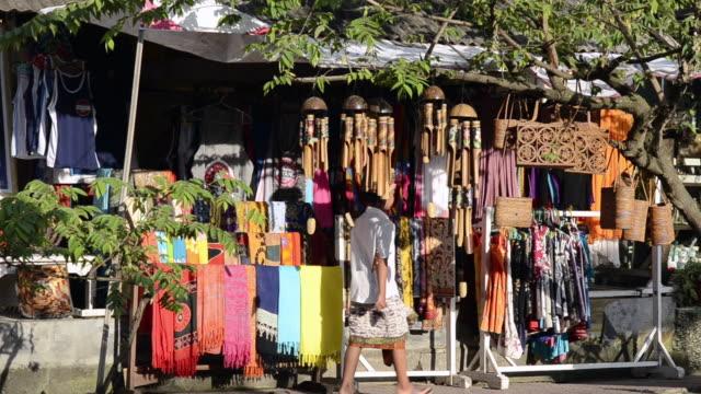 ms balinese passing souvenir shops at jalan hanoman shopping street / ubud, bali, indonesia - indonesia stock videos & royalty-free footage