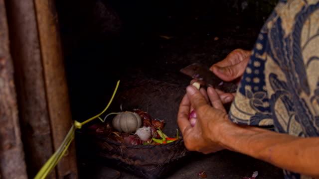 LS Balinese Senior Woman Peeling The Garlic