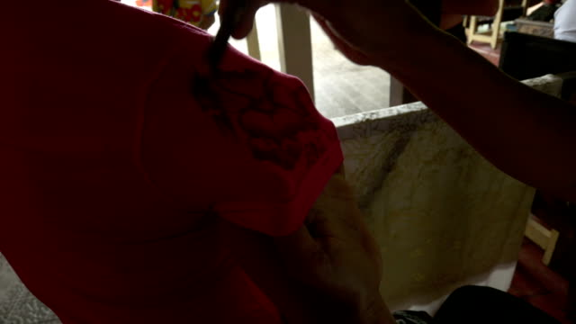 ms balinese textil painter at work - painting art product stock videos & royalty-free footage
