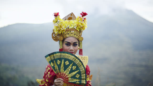 balinese traditional legong dancer performing in front of mount batur volcano - ubud district stock videos & royalty-free footage