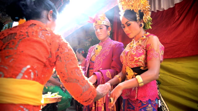 balinese wedding bride and groom in local ceremony - bali stock videos & royalty-free footage