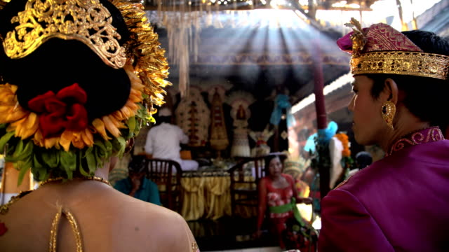 balinese wedding bride and groom in local ceremony - gold dress stock videos & royalty-free footage