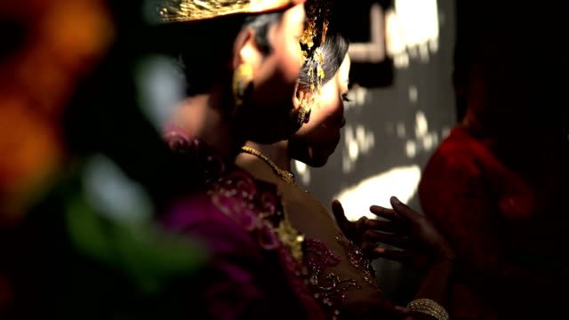 Balinese wedding bride and groom in local ceremony