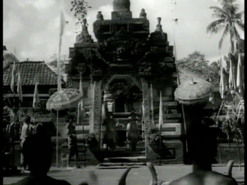 balinese women topless walking carrying baskets on head pagodas bg vs female balinese dancers under temple archway ms dancer w/ costume arrow ms... - carrying stock videos & royalty-free footage