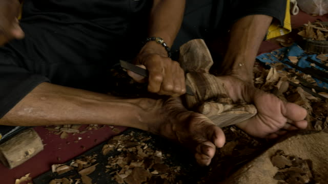 stockvideo's en b-roll-footage met ms balinese woodcarver doing his craft - carving craft product