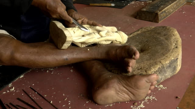 stockvideo's en b-roll-footage met cu balinese woodcarver doing his craft - carving craft product