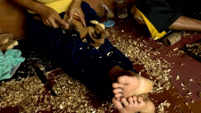 stockvideo's en b-roll-footage met ms balinese woodcarvers at work - carving craft product