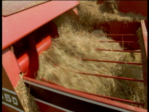 baling machine collects hay, devon - machinery stock videos & royalty-free footage