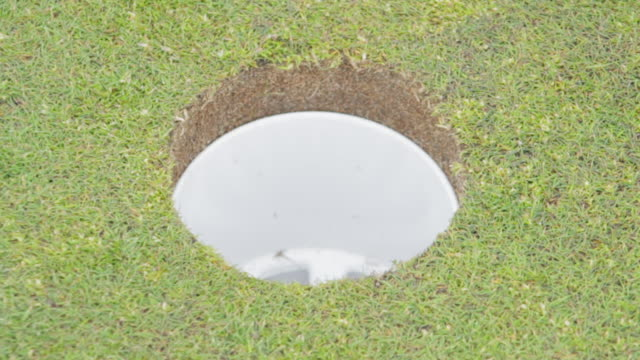 Ball Enters the Hole and Pin Replaced