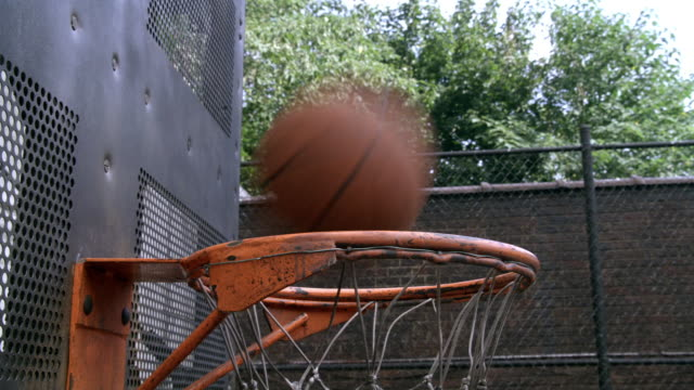 cu, ball falling through basketball hoop - shooting baskets stock videos and b-roll footage
