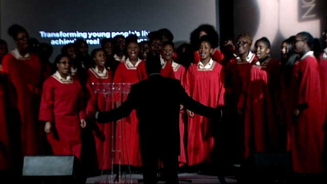 ball held to mark 20th anniversary of death of stephen lawrence; england: london: int choir singing candles on tables at ball choir on stage - choir stock videos & royalty-free footage