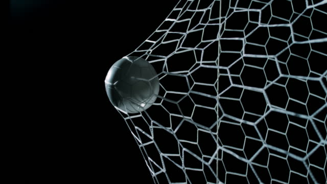 vídeos de stock e filmes b-roll de slo mo ball hitting the football net - football