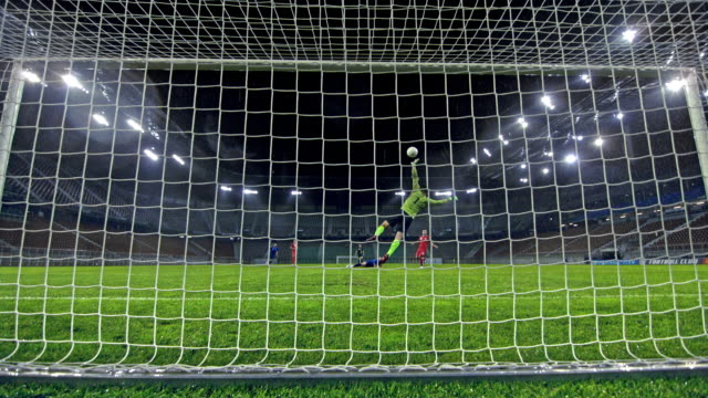 vídeos de stock e filmes b-roll de slo mo ld ball hitting the net after the goalkeeper fails at defese - fim