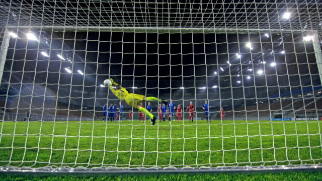 SLO MO LD Ball hitting the net when the goalkeeper fails at defense