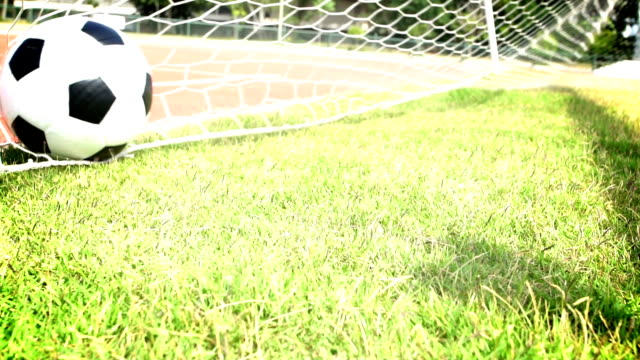 ball in soccer goal net - netting stock videos & royalty-free footage