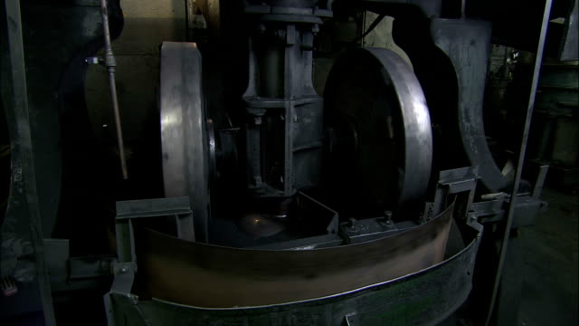 a ball mill mixes clay and graphite in a pencil manufacturing plant. - graphite stock videos & royalty-free footage