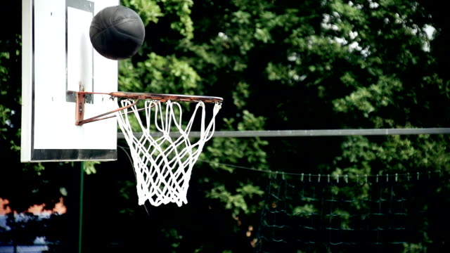 hd super slow-mo: ball missing the hoop - shooting baskets stock videos and b-roll footage