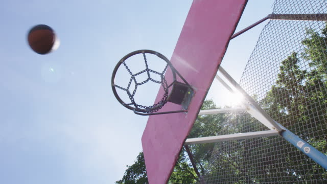 ball passing through basketball hoop - basketball hoop stock videos & royalty-free footage