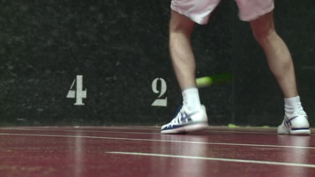 A ball shunts along a slanted ledge before dropping to the floor and bouncing onto the strings of a waiting racquet