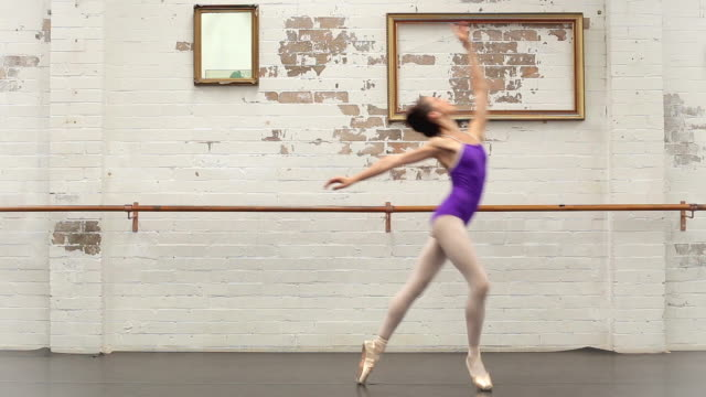 ballerina dances from left to right - gymnastikanzug stock-videos und b-roll-filmmaterial