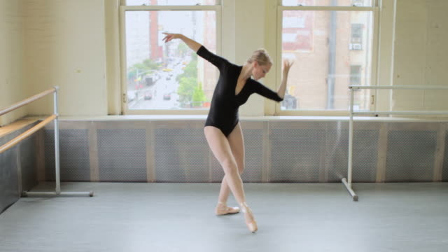 ballerina dancing in studio - collant video stock e b–roll