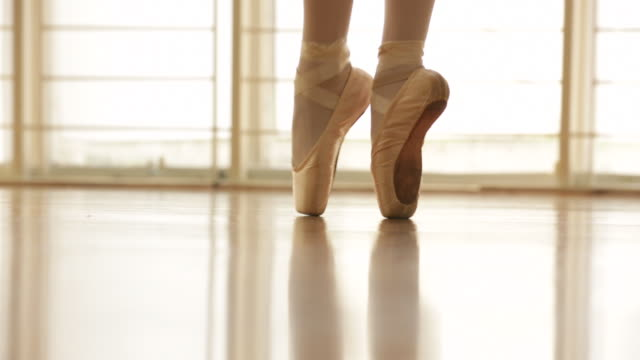 cu ballerina en pointe. - ballet shoe stock videos and b-roll footage