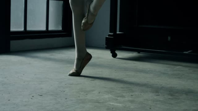 ballerina girl trying to balance on toes in studio - stock video - passion stock videos & royalty-free footage