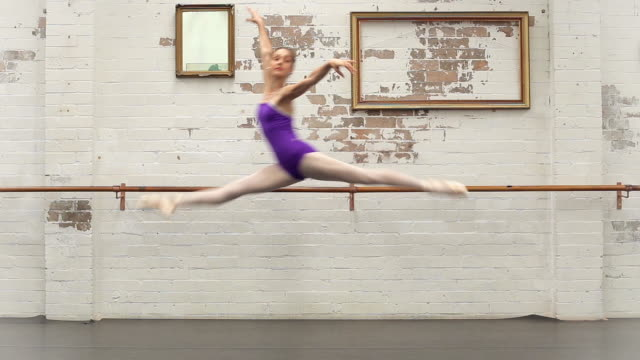 ballerina jumps from right to left - gymnastikanzug stock-videos und b-roll-filmmaterial