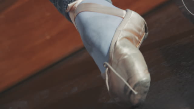ballerina moving her feet on floor in studio - ballet shoe stock videos & royalty-free footage