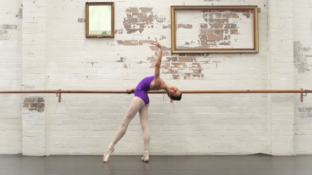 ballerina performs different figures - gymnastikanzug stock-videos und b-roll-filmmaterial