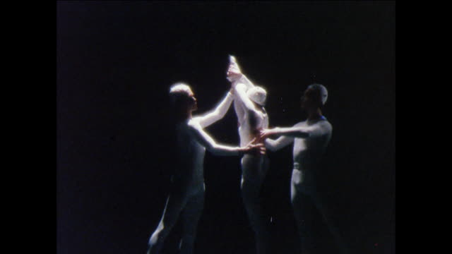 montage ballerina performs dramatic pirouettes with dancers / uk - human limb stock videos & royalty-free footage
