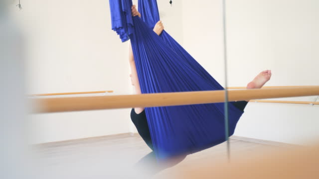 ballerina practicing using a hammock. - ballet studio stock videos and b-roll footage