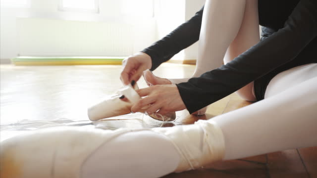 ballerina preparing for training. - ballet shoe stock videos and b-roll footage