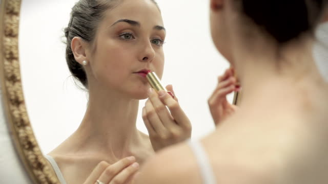 ballerina puts on lipstick - young women stock videos & royalty-free footage