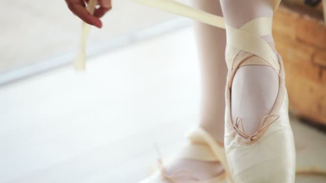 ballerina putting on her shoes - ballet shoe stock videos and b-roll footage