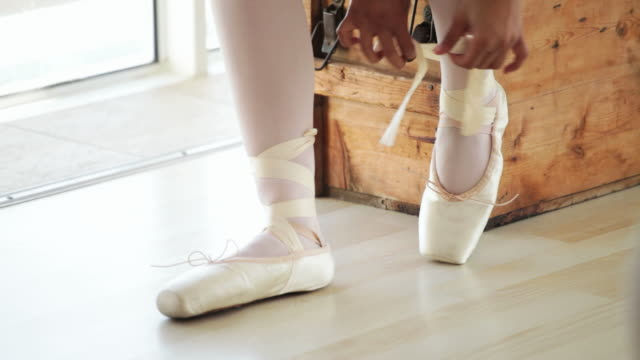 ballerina putting on her shoes - dress shoe stock videos & royalty-free footage